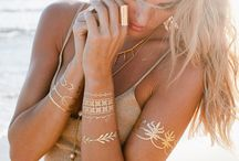 Lulu DK Tattoos | Temporary Metallic Tattoo / Lulu DK creates gold and silver metallic jewelry inspired temporary tattoos for the girl with a gypsy soul. This collection features designs such as dainty bracelets, tropical plants, love written in cursive, and pretty arm bands. Apply a couple of these gorgeous little pieces to complete your look, day or night! You can choose to use all gold, all silver, or mix and match the two for a unique jewelry tattoo look. #jewelrytattoo #metallictattoo #luludk