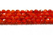 Carnelian Natural Gemstone Beads / Get the best natural Carnelian Gemstone beads from African Mines. Available in clear faceted cut beads. A bead measures from 9mm to 12mm