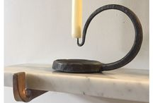Interior metalwork / forged metalwork for interiors, candlesticks, fireplace tools, fire baskets and lighting