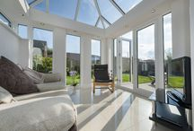 Livinroom and Cornice / Livinroom is the best of both worlds, combining the light and sky of a conservatory with the walls and ceiling of an extension. Livinroom is truly multi-functional, creating a pleasant and relaxing space for meditation or it can be a 'full on' family room. Change the visual dynamics externally too by using Cornice for a smooth finish at the wall/roof interface.