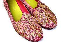 Crimson / A printed and embossed suede shoe with golden ambroidery.