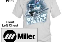 """Miller Welding Tee Designs / PDI developed these slogans and creative designs to be printed on tee shirts for the Miller Welding Company, maker of Miller welding equipment.  PDI works with it's clients as a """"Branding Mentor™"""" in the promotional merchandise arena from concept, design to finished product. Why pay more for cool welding tees and designs when you can by them direct from Miller and Save! Most regular sized tees are under $10.00.  http://www.millerweldsstore.com/guests"""
