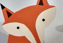 Mr Foxy / This nursery mural was painted for an unborn baby. At the time of painting the gender of the child was unknown. The mother Jo has since had a beautiful baby boy. The walls were painted with stylish and simple silver birch trees, which were accompanied with simple british woodland animals. The monochrome walls were offset with an orange colour theme that was set by the Fox. This two tone colour effect ran as a theme throughout the nursery.
