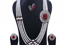 Magnificent 4 Lines Pearl Necklace Set in Ruby Red Onyx Pendant at Rs.13,900