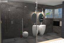 koupelna v šatně nebo šatna v koupelně - očkodesign / Barevnost v návrhu jsem zvolil tak, aby působila příjemně ale hlavně útulně kvůli přímému sousedství s ložnicí. Některé z prvků budou zopakovány i v ložnici, ať už to bude tapeta s písmem, která je nyní za obrazem a kosmetickým stolkem, anebo betonová stěrka která je na stěnách v koupelně. Bonbónek: takřka komixová imitace květiny v květináči na levo od záchodu, je designový záchodový kartáč (štětka) od výrobce Alessi. Ano, i taková věc může mít nápad a může vás potěšit :). Petr Molek očkodesign