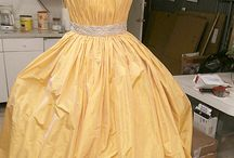 Erato Wedding Dress in Buttercup or Coral / Buttercup Yellow Dress - One or our retail customers in Japan custom ordered our Erato gown in stunning Buttercup yellow for their chain of bridal stores.  From the moment we started hand-draping the vertical-pleat bodice, we knew we were working on one of the most striking dresses ever to leave our studios.  Erato has the distinction of being the dress with the largest skirt in our collection (pockets included, of course!) #erato #yellow #weddinggown #japan #weddingdress #couture #nyfw