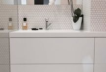 Elegant white bathroom with composite washbasin with countertop.