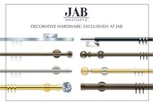 Drapery Hardware Jab Anstoetz / Jab Anstoetz has an array of decorative drapery hardware systems to meet your design needs. Ask about the Ripplefold traversing system and the Integral system. There are a  wide variety of poles and finials to choose from. Call Jeffrey Michaels for more info.