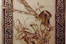Woodburning fairies, dragons, greenmen