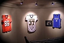 Man Cave / Man Caves with lots of sports jerseys on display.