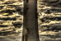 Lighthouses / Lighthouses don't go running all over an island looking for boats to save; they just stand there shining