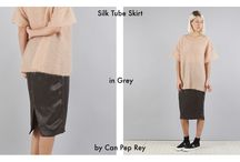 Our Thing TUBE SKIRTS / Tube Skirts are an essential in every woman's wardrobe; their figure hugging and high waisted design creates a streamlined silhouette that suits everyone. Our selection includes nudes from Nanushka and Filles A Papa, sporty options from DKNY and beautiful use of material from Can Pep Rey and Aries. Play with proportions by adding something loose or oversized on top and keep it simple with a pair of Vans.