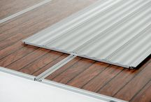 The RV Deck - The Shore Series / The Shore Series is crafted of the finest quality engineered marine-grade outdoor decking. With a a choice of teak or classic mahogany plank appearance, quality and finish are uncompromised.  The Shore Series is truly a no-maintenance option for dressing up your RV exterior. With no ongoing maintenance required to keep your RV Deck looking like new for many years to come, the Shore Series is the  most durable, no-maintenance option.