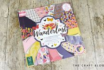 First Edition Wanderlust / Wanderlust, designed by the wonderful Katie Pertiet, is adorned with a warm flourish of floral patterns, intricate leaves, buzzing bees, fluttering butterflies and more. The enchanting illustrations will be sure to help your handmade projects radiate with the magic of nature! The navy, pink and yellow papers will be sure to infuse your crafts with an elegant and stylish look.