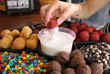 Doughnut Fondu / Move over chocolate fondue! Glazed & Infused doughnut fondue platters are a guaranteed crowd-pleaser.  Perfect for kid's parties, cocktail parties and more, the doughnut fondue platters let you create your own delicious  doughnut combos using our vanilla, chocolate or red velvet doughnut holes, flavored glaze and an assortment of  toppings. The fondue platter selections may also be used to create a custom doughnut bar.