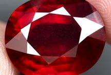 Ruby, Birthstone of July / The glowing ruby shall adorn, Those who in July are born; Then they'll be exempt and free From love's doubts and anxiety