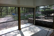 Screened in porch underneath a deck / By installing a RainTight under deck ceiling you can keep the area under your deck dry. Your under decking ceiling installation can then be kept bug free by adding screen walls to your new area under deck.  The under deck system combine with the aluminum screen walls will give a great space to enjoy your days bug free.