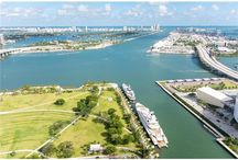 FOR SALE ~ 900 Biscayne Bay #4706 / HIGH FLOOR UNOBSTRUCTED VIEWS OF BISCAYNE BAY, OCEAN & CITY OVERLOOKING MUSEUM PARK. Most desirable 3 Bedroom + Den, 4 Bathroom Corner unit with 24 x 24 ivory porcelain floors throughout unit & terraces. Open Kitchen w/ Carrara Marble countertops, Dark Wenge Italian cabinetry, Miele & SubZero appliances. Custom Linen blackout Curtains, 10 foot high Ceilings, Private Elevator Entry Foyer | Listed For: $1,695,000