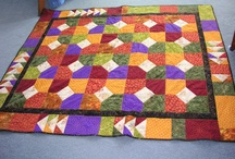 My humble work / I am a quilter with my own business making custom quilts and offering restoration services. I also make quilts from other designers patterns, customizing color and quilting per customer request. If it is not my design, credit to the designer is ALWAYS provided.This is some of what I do. / by Michelle Brewster