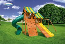 Sky Swing Sets / The Sky Swing Set #1 The Sky's the limit with this multi level, two tower unit. (one is 5 1/2' high and the other is 7′). The Sky #1 includes a 7' Deluxe Rock Climbing Wall, Steel Rung Access Ladder, 7' Spiral Tube Slide, 10' Wave Slide,  and a 3 position 4x6 swing beam 2 Sling Swings and a Plastic Horse Glider. There's plenty of room for everyone with over 43 sq.ft. of deck space inside the clubhouses. Plus with over 6 1/2' of standing height even adults can play!
