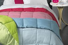 Duvets 2016-17 / Two colors, two prints, two sides. As a duvet or as a quilt. We introduce a new concept in bedding. Warm and correct color combination. Game between face and back: printed and plain. Light and warm, with or without cover: your bed is complete and covered in one move. Its composition allows to be machine-washed if needed.