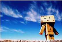 "Danbo The Cute Box / Danbo, the robot out of cardboard boxes that is now popular subject of digital photography, is a character from a comedy manga series by Kiyohiko Azuma entitled Yotsuba&!, read as ""Yotsuba to"" which means ""Yotsuba and""."
