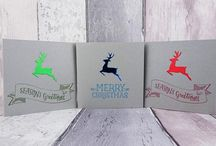 Christmas cards, gifts, accessories and home decor featuring reindeer (including Rudolph)