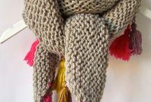 triángulo con borlas en lana