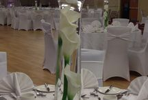 Centerpiece / Cala lily centerpiece and spandex chair covers