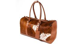3.7.6. Travel Bag XL LTU01 (315141) / Brown and white cow's hide and goldentan natural leather, brown fabric inside Size (mm) 650 x 280 x 300