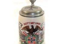 Imperial German Militaria / Collectible Imperial German militaria including helmets, cartridge box plates, German beer krugs, and partizans.
