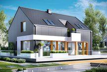 HomeKONCEPT 17 | Projekt domu / HomeKONCEPT-17 jest doskonałą propozycją dla ludzi poszukujących rozwiązań minimalistycznych i ultranowoczesnych. Wyjątkowa, geometryczna bryła z unikatowym wcięciem, rozległy taras wyniesiony nieco ponad poziom dom gruntu oraz bezokapowy dach to elementy, które z pewnością wyróżniają ten dom. Grafitowe płyty elewacyjne połączone z białym tynkiem zastosowanym na ozdobnych detalach nadają całości jedynego w swoim rodzaju, wyszukanego wyglądu.
