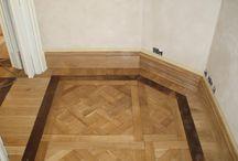 Instalación de parquet mosaico en habitaciones de una casa particular