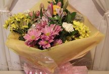 Handties Start from £25 / Handties are excellent gifts as the fresh flowers are already arranged in a decorative box with cellophane and a complementary ribbon. As water has already been added to the arrangement there is nothing else to do apart from enjoy the beauty of the gift.