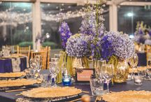 Majestic Midnight Blue / Majestic midnight blue with grand gold flatware and ornate charger plates formed the base to this beautiful styling. The smart use of on trend patterned napkins with a complementing stationary suite of menu, table number and individual place cards cleverly tucked into each guest golden fork. This setting sat under a canopy of warm white fairylights that shone brightly above guests tables laden with stunning florals and candlelight.  Youtube: www.youtube.com/watch?v=xfwLgKtlLyE  Enchanted Empire