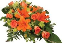 Orange/ yellow funeral arrangements