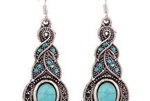 earnings she likes / she likes turquoise (or blue Howlite ) simple drop earrings with a pewter silver look also diamante or tiny rhinestones also hoop earrings other stones she likes are tiger eyes and Onyx.