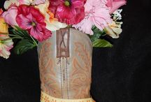 Floral Boot Arrangements / Artificial flowers in upcycled boot vases.