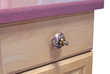 Carnival Knobs are Free Spirits / Noted for exquisite hand painted scrolly artwork and rich saturated jewel tone colors, Carnival cabinet knobs are lively, festive and versatile.