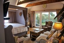 Stardust / Luxury self-catering.  Riverside and seafront boathouse with hot tub and shepherd's hut kitchen-diner.  http://pool-house.co.uk/stardust.php