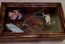 Wedding shadowboxes / Our custom shadowboxes help you to preserve the memories of your special day.  We can build a smaller frame holding only the photos and cake topper or a larger one that could even contain the wedding dress! / by Frame Escape