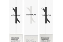 Wishbhone - Packaging Design / PACKLAB - Packaging Design. Packaging and brand design for Wishbhone earphone cord manager product. Designed with one sheet of material the packaging folds in on itself and suspends the product to give it the impression as if it is floating. Winner of two UK Starpack design awards for Structural Packaging Design and for Product-Packaging Integration. 