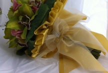 Cymbidium and hydrangea bouquet all wrapped up in a big gold bow / Lime real touch cymbidium orchids, pink silk hydrangea and crystal highlights all wrapped up in a big gold satin and organza bow finished with a crystal knot and a silver fluttering butterfly by Iridescent Blush Blooms. Contact iridescentblushblooms@netspace.net.au to great you keep sake bouquet.