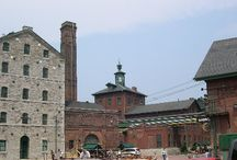 St. Lawrence Market/Distillery Condos and Lofts, Toronto / Celebrate the past and raise a glass to the future! This historic district wears its heritage on its sleeve. Downtown condominiums and lofts are an intoxicating blend of the vintage and contemporary. Many still bear their original brick and stone facades, stately reminders of York's industrial and financial past. Stroll to a café or pub along brick-paved streets. Browse for antiques. Take in a play. Shop at historic St. Lawrence Market. Something's always brewing in this hip cultural hotspot!