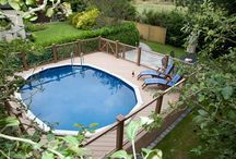 Composite  decking by Westend Landscapes / Swimming pool installed with decking surround.