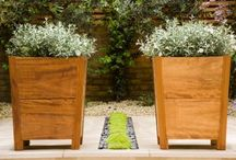 Garden pots and planters / Pots and planting containers in gardens and terraces designed by Charlotte Rowe Garden Design