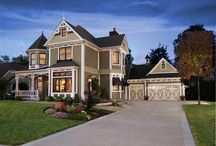 Coachman Garage Doors / Clopay's Coachman Collection steel and composite carriage house style garage doors are a low-maintenance insulated alternative to natural wood doors. Fifteen panel designs in four paint colors with optional windows and decorative hardware.
