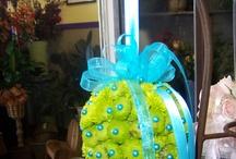 kissing balls / kissing ball or a pomander  (a lush ball of flowers),