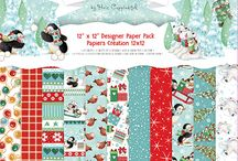 Helz Cuppleditch Wonderland / Be drawn into a little wintery world of playful penguins and snuggly polar bears with Helz Cuppleditch's Christmas collection, Wonderland. This endearing selection will be sure to warm the heart of anyone who encounters it! This collection features vibrant 150gsm paper packs adorned with illustrations of brightly lit Christmas trees, sledging penguins, fairy lights, robins and pretty repeat patterns, a perfect selection to bring any festive project to life.
