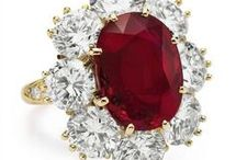 July Birthstone - Ruby Jewelry / The Ruby is the captivating stone for July. Rubies are considered to be the king of gems, representing love, health and wisdom. It is said that wearing a Ruby brings the owner good fortune. The value of a ruby is based upon its color and its quality, and depending on these two factors the value will increase!